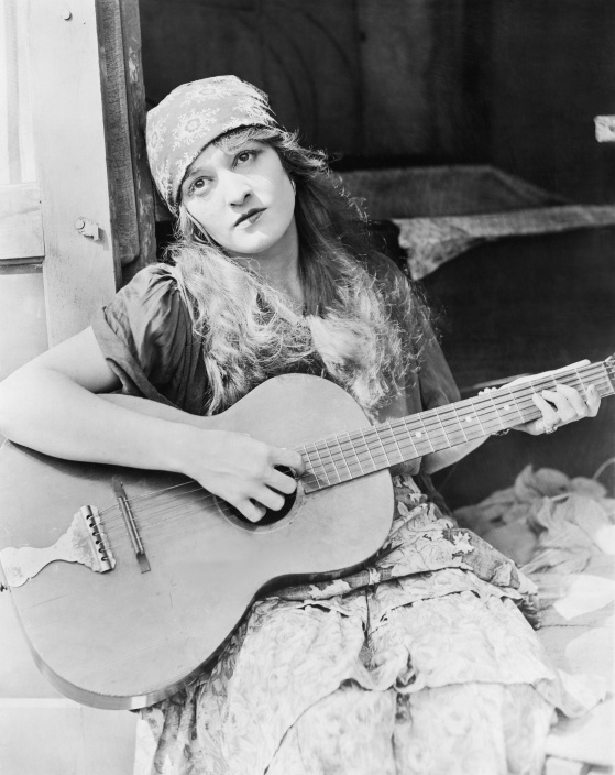 Portrait of woman playing guitar
